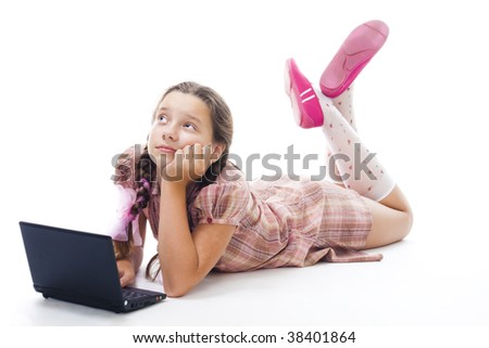Teenager girl with laptop thinking laying,isolated on white
