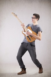 Teenager holding an electric guitar