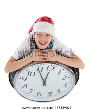 Teenager in cap of Santa Claus and large clock, isolation