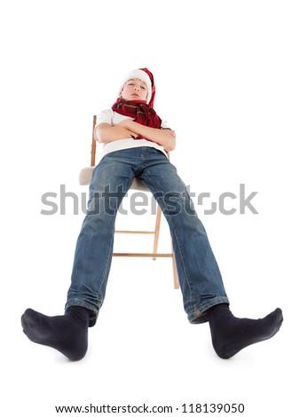 Teenager in cap of Santa Claus, isolation, studio