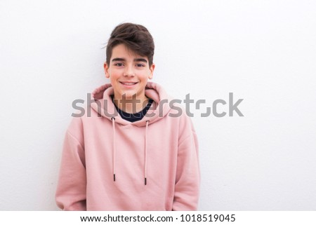 teenager in the isolated white wall #1018519045