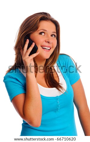 Teenager is happy while talking on her cell phone