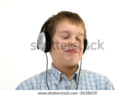 Teenager is listening to the music with headphones