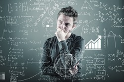 Teenager is thinking of a solution to a math formula