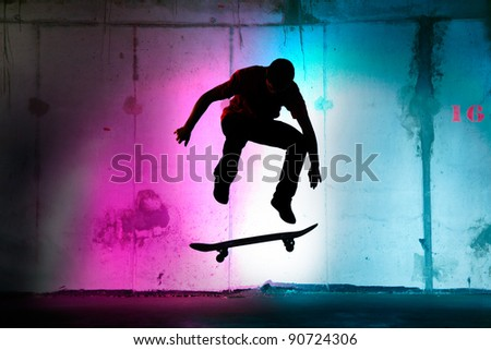 teenager jumping, skateboarding at night black silhouette