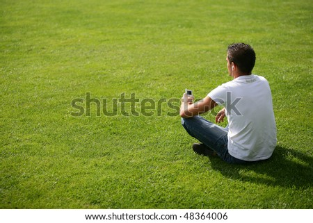 Teenager listening to music in park