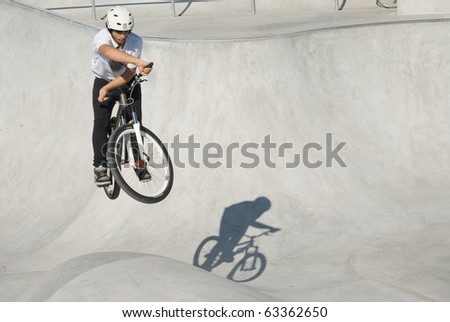 Teenager on Dirt Bike at Skateboard Park