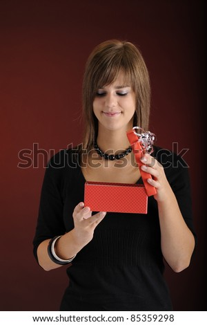 teenager opening a gift box