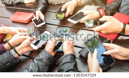 Teenager people having fun using smartphones - Millenial community sharing content on social media network with mobile smart phones - Technology concept with millennial playing with cellphone devices