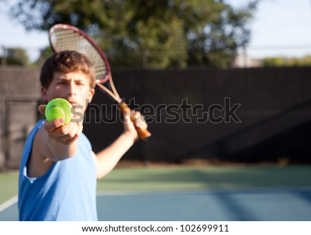 Teenager playing Tennis with determination