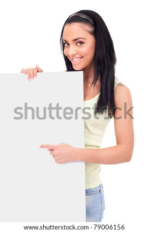 teenager pointing at a blank board, smiling cute girl,  isolated on white background