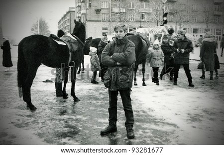 Teenager poses for the camera during New Year celebrations, Kamensk Shakhtinsky, Rostov region, circa 1996 (very grainy image)