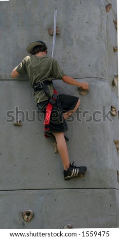 teenager rock climbing