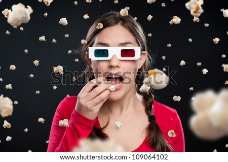 Teenager sees a shower of popcorn raining down on her in a 3D cinema