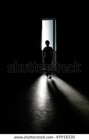 Teenager silhouette with shadow in dark background