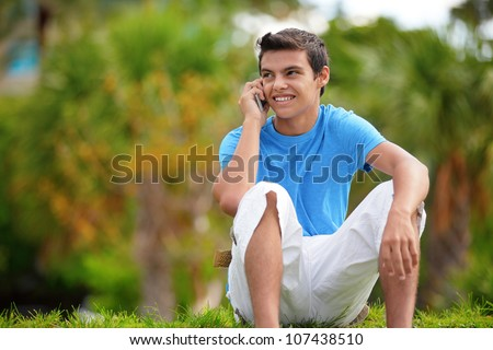Teenager sitting and talking on the phone