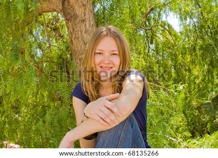 Teenager sitting near the wall.