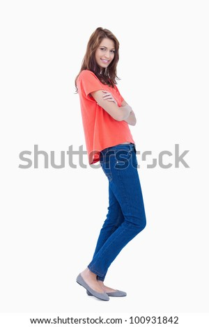 Teenager standing in a relaxed way against a white background