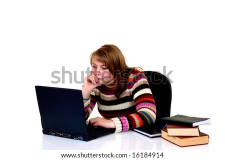 Teenager student doing homework with laptop and books on desk, with background, reflective surface