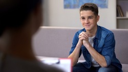 Teenager visiting psychotherapist, successful drug addiction rehabilitation