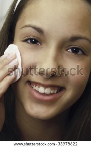 teenager washing face