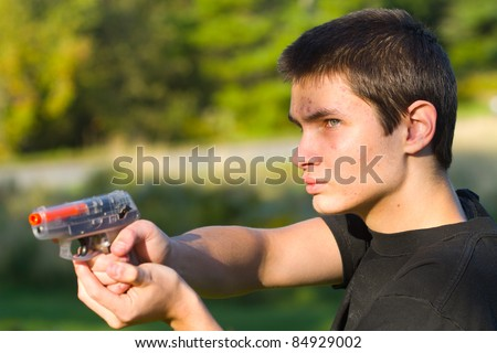 teenager with a pneumatic weapon
