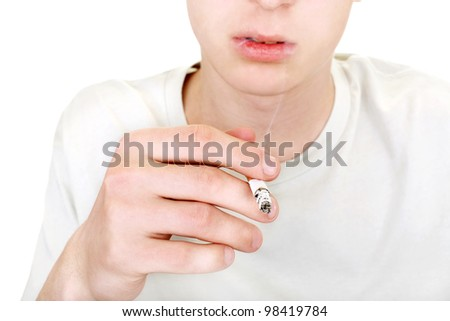 teenager with cigarette closeup. isolated on the white background