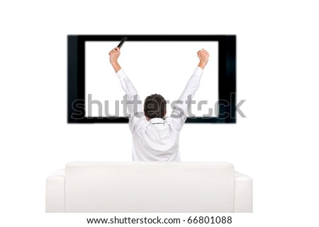 teenager with hands up watching tv-set