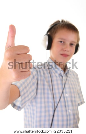 teenager with headphones laughing and showing OK