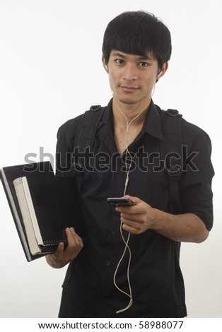 Teenager with music player and earphones