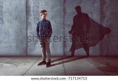 Teenager with superhero shadow