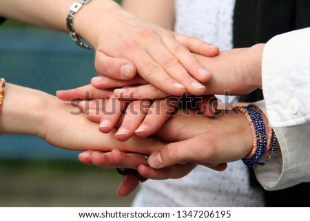 Teenagers hands together Conceptual Picture