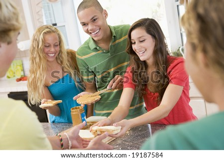 Teenagers Making Peanut Butter Sandwiches stock photo