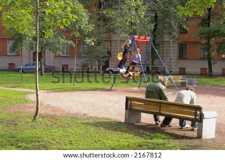 Teenagers on a play ground at backyard.