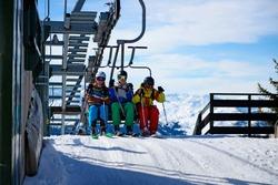 Teenagers on ski lift on skiing holiday, Tirol, Austria, Europe