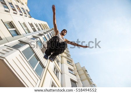 teenagers paired training parkour jump in the urban environment #518494552