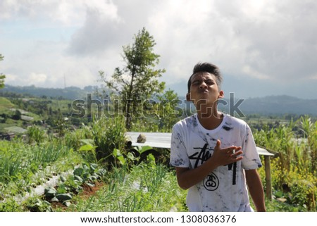 teenagers play on the hill to see the sights and see clouds, in magelang indonesia 3 february 2019 #1308036376