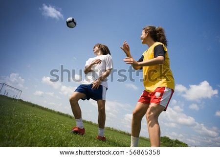 teenagers playing football