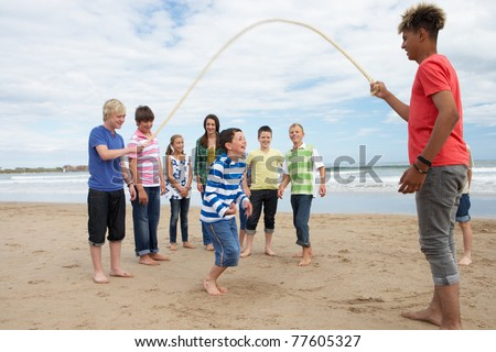 Teenagers playing skipping rope