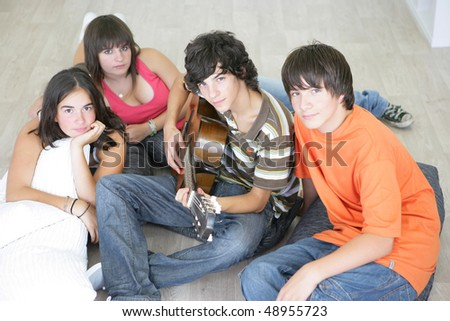 Teenagers playing the guitar