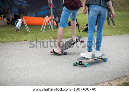 Teenagers ride their skate boards and chilling at summer festival or in park. Concept of healthy, active lifestyle, sport and recreation. #1307498740
