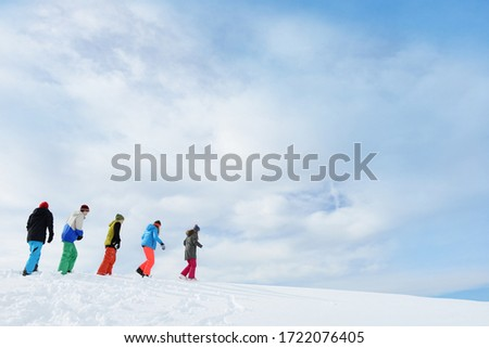 Teenagers walking on skiing holiday, Tirol, Austria, Europe