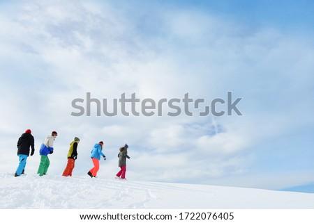Teenagers walking on skiing holiday, Tirol, Austria, Europe