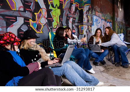 Teenagers working on their laptops with grunge background
