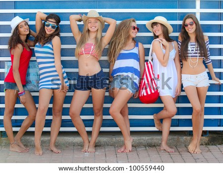 teens girls in beach wear at summer vacation or spring break