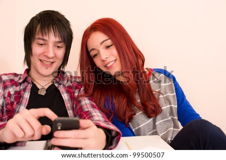 Teens reading some content that makes them smile