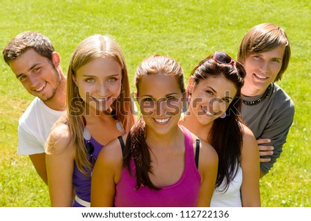 Teens relaxing in the park friends happy leisure young students