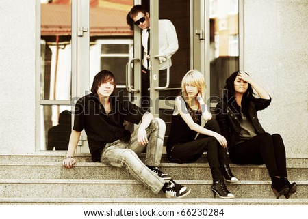 Teens relaxing on the steps.