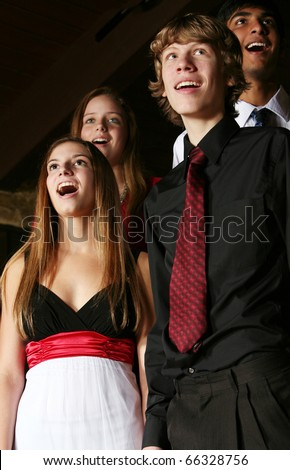 teens singing in choir in formal dress