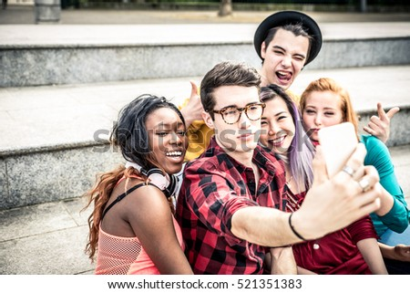 Shutterstock Teens taking selfie with phone